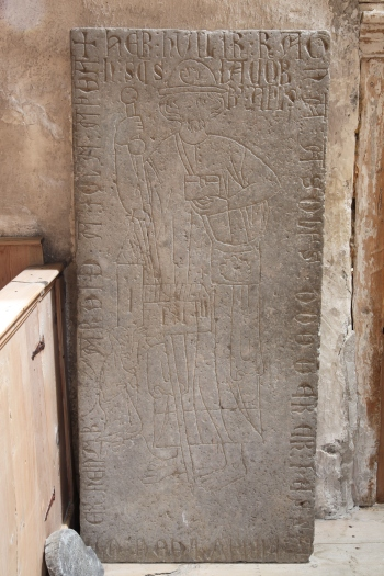 Medieval grave stone in the chancel (photo Justin Kroesen)